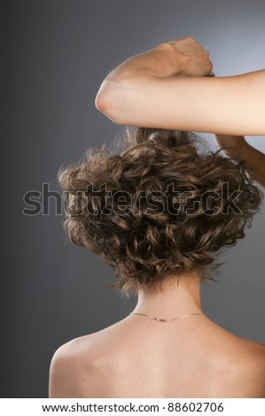 Stylist updo young blonde woman. Studio photo.