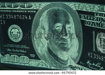 Stylized black and green negative of standing 100 dollar bill with selective focus - stock photo
