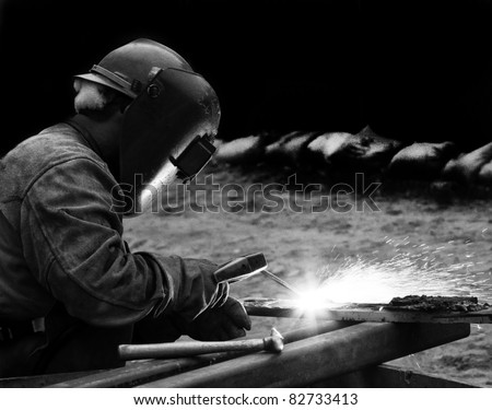 Stylized Black and White of Arc Welder Working at Construction Site