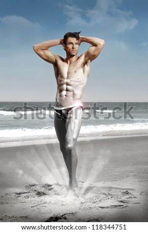 Stylized conceptual sexy portrait of a very muscular shirtless male model  in sensual pose transforming from silver black and white to color - stock photo
