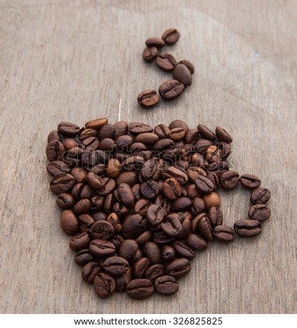 Stylized cup of coffee out of coffee beans - stock photo