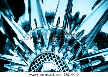 Stylized image of sport car chrome plated wheel - stock photo