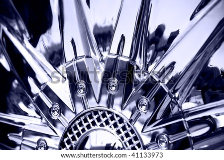 Stylized image of sportcar chromeplated wheel - stock photo