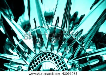 stylized image of sportcar chromeplated wheel - stock photo
