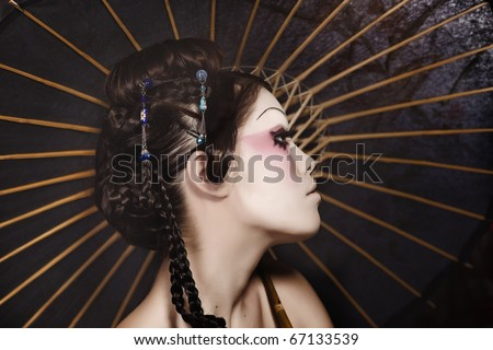 stylized picture of a Japanese geisha, make-up done by professional Polish artist - stock photo