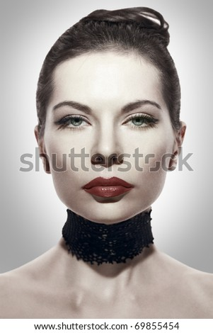 Stylized portrait of a brunette young adult woman - stock photo