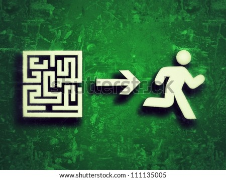Stylized running human silhouette, which is leaving the exit of a labyrinth, representing concepts such as problem solving, success, and action of overcoming difficulties - stock photo