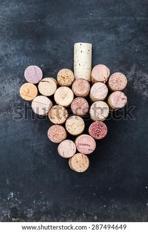 stylized wine grape from used wine corks - stock photo