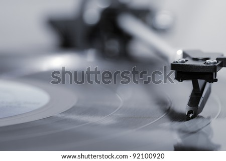Stylus on a vinyl LP record. - stock photo