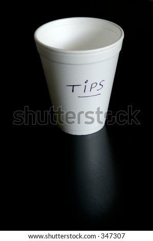 Styrofoam glass for tips. Empty. - stock photo