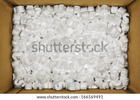 Styrofoam Packaging Peanuts Inside Cardboard Box Photo - stock photo