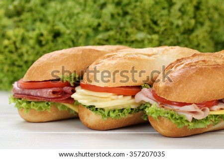 Sub deli sandwiches baguettes with ham, salami, cheese, tomatoes and lettuce