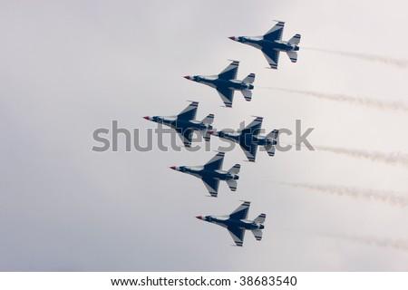 SUBANG, MALAYSIA - OCTOBER 3: The U.S. Air Force F-16 Thunderbirds fly in formation at the Thunderbirds Airshow in Malaysian Air Force Base on October 3, 2009 in Subang, Malaysia. - stock photo