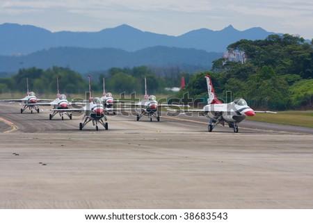 SUBANG, MALAYSIA - OCTOBER 3: The U.S. Air Force F-16 Thunderbirds taxiing down the runway at the Thunderbirds Airshow on October 3, 2009 in Subang, Malaysia. - stock photo
