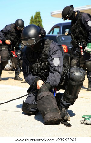 Subdivision anti-terrorist police during  a black tactical exercises. After rope techniques. - stock photo