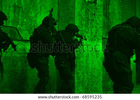 Subdivision anti-terrorist police during a black tactical exercises. Entry to the premises. Real situation. View through the night vision device.