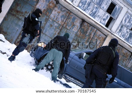 Subdivision anti-terrorist police during a black tactical exercises. Stopping the suspected vehicle and drivers. Real situation. - stock photo