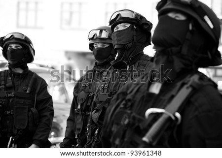 Subdivision anti-terrorist police observed a black tactical exercises. Black and white photo. - stock photo