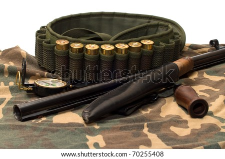 Subjects of the hunting ammunition on a camouflage fabric. - stock photo