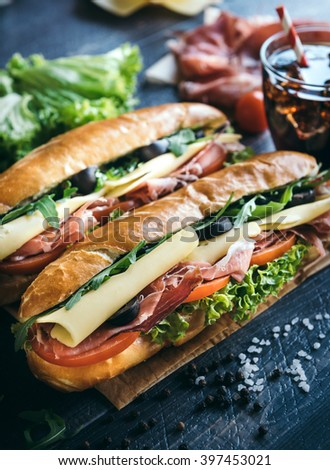 Submarine sandwiches served on the table,selective focus  - stock photo