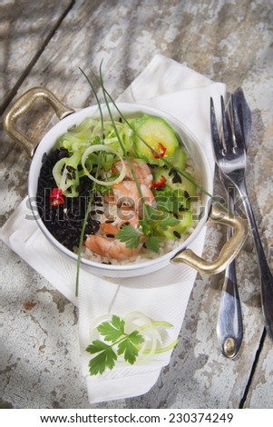 Submission of a second dish of white rice and black with shrimp and zucchini - stock photo