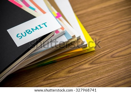 Submit; The Pile of Business Documents on the Desk - stock photo