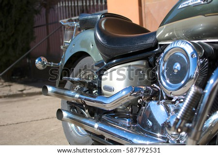 Subotica, Serbia-February 25,2017:Green Yamaha DragStar 1100 motorcycle in front of the garage, photographed on a nice sunny day. Ready for restoration. Lot of chrome detail.