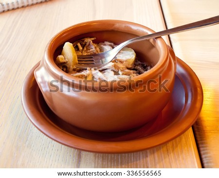 Substantial roasted meat with potato in a pot, Russian cuisine