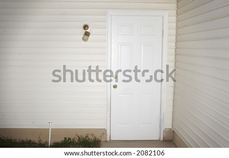 Suburb Door with Siding on the house and a broken light fixture