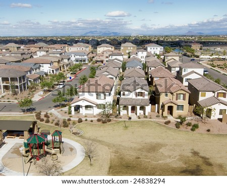 Suburban Arizona community shot from high vantage point looking down onto a housing development