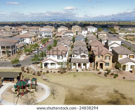 Suburban Arizona community shot from high vantage point looking down onto a housing development - stock photo
