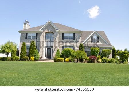 Suburban Brick Home in Residential Neighborhood - stock photo