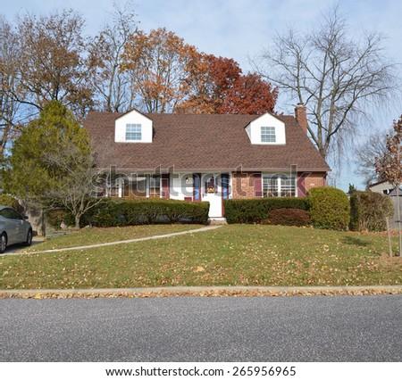 Suburban cape cod style home residential neighborhood USA - stock photo