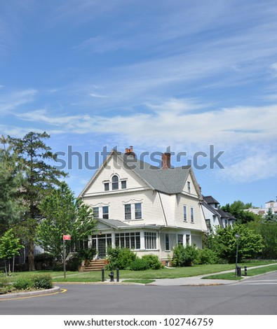 Suburban Corner Victorian Style Home in Residential Neighborhood - stock photo