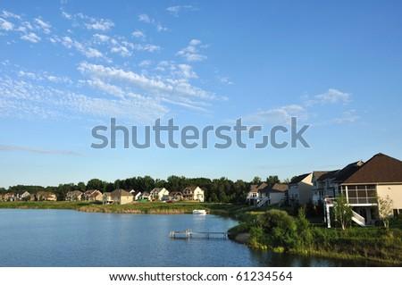 Suburban Executive Houses on Lake with a Blue Sky - stock photo