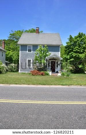 Suburban Gable Style Home Residential Neighborhood Sunny Blue Sky Day - stock photo