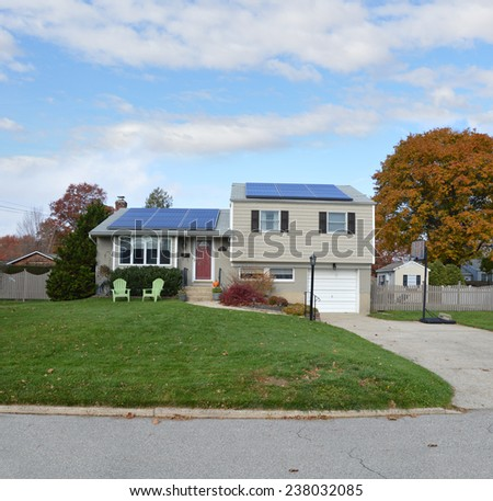 Suburban high ranch house autumn day residential neighborhood blue sky clouds USA - stock photo