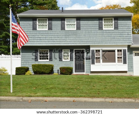Suburban High Ranch Style Home autumn fall day sunny residential neighborhood USA blue sky clouds - stock photo