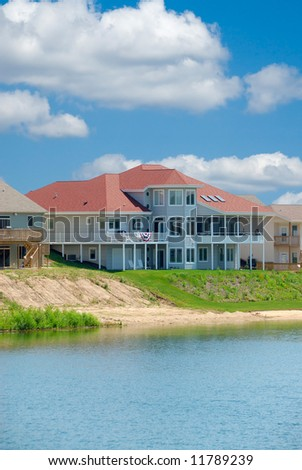 Suburban Home - A beautiful three story vinyl siding home on a lake in Michigan, USA.