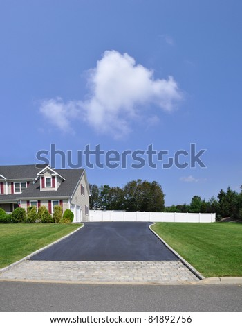 Suburban Home Driveway Brick and Blacktop
