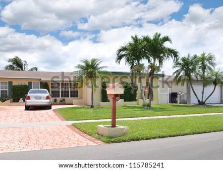 Suburban Home Mailbox Parked Car Palm Tree - stock photo