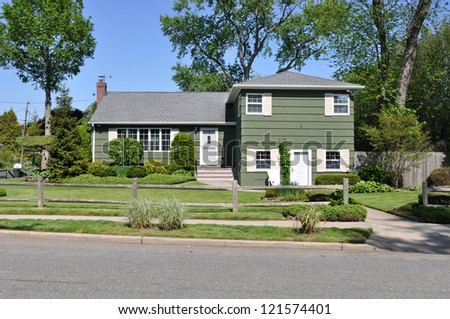 Suburban Home Snout Back Split Style Architecture Residential Neighborhood Sunny Day Blue Sky
