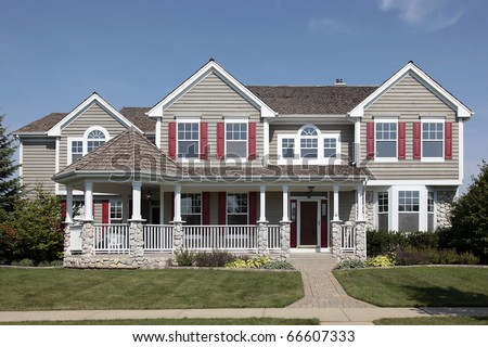 Suburban home with cedar roof and front porch - stock photo
