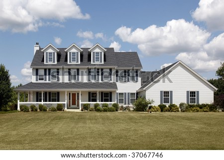 Suburban home with large front yard and porch