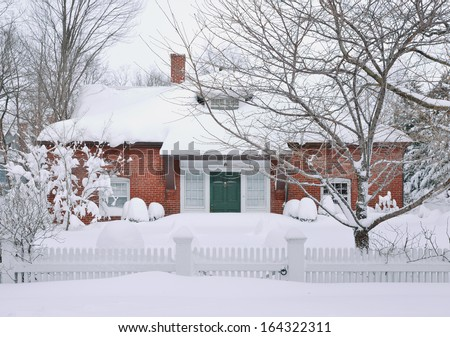 Suburban house covered in snow - stock photo