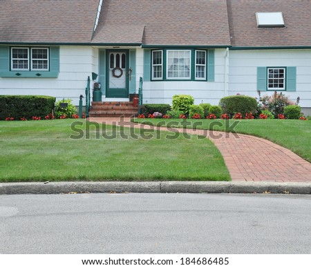 Suburban House front Landscaped with brick walkway flowers residential neighborhood USA - stock photo