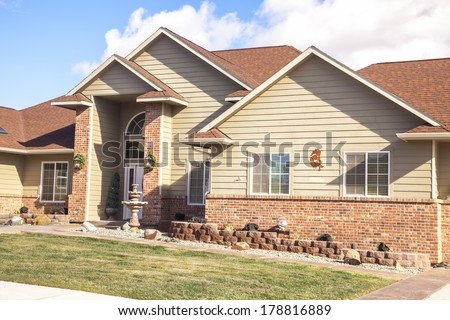 suburban house on a beautiful sunny day  - stock photo