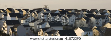 Suburban landscape shows cookie-cutter residential housing - stock photo