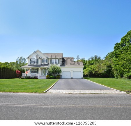 Suburban McMansion style Home Blacktop Driveway Landscaped Front Yard Lawn - stock photo