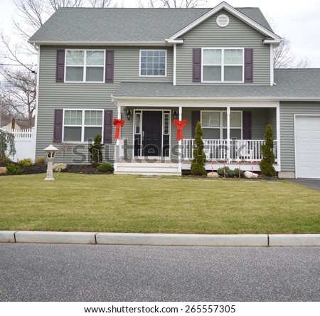 Suburban McMansion style home overcast day residential neighborhood USA - stock photo